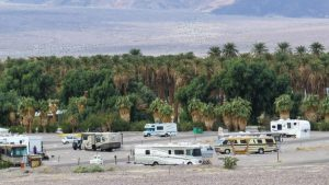 An overview of Sunset Campground with Furnace Creek Ranch's date grove and valley floor in the background